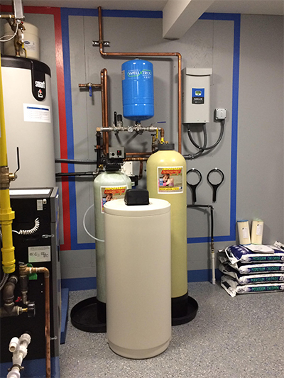 Softener, downflow carbon, constant pressure well pump system